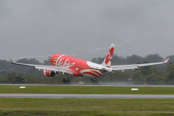 MMPI_20200208_MMPI0063_0037 - AirAsia X Airbus A330-343 9M-XXT (Xcintillating PhoeniX Livery) as flight D7200 touches down at Gold Coast Airport (YBCG) ex Kuala Lumpur (WMKK) trailing wingtip vortices.