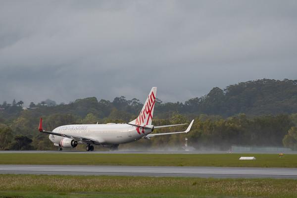 MMPI_20200208_MMPI0063_0002 - Virgin Australia Boeing 737-8FE VH-YFV as flight VA500 spraying water on its takeoff roll from Gold Coast Airport (YBCG) bound for Sydney (YSSY).