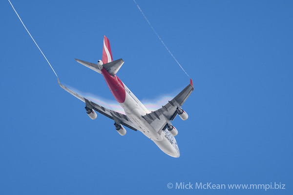 QANTAS 747 With Condensation Cloud