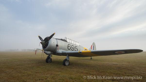 CAC CA-16 Wirraway VH-MFW in a foggy sunrise