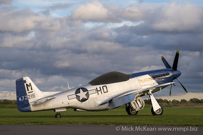 "North American P-51D Mustang ""Miss Helen"" G-BIXL parked on the grass outside the Aircraft Restoration Company"