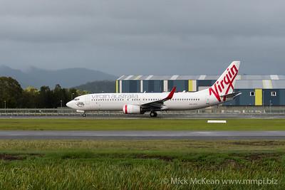 MMPI_20200208_MMPI0063_0001 - Virgin Australia Boeing 737-8FE VH-YFV as flight VA500 beginning its takeoff roll from Gold Coast Airport (YBCG) bound for Sydney (YSSY).