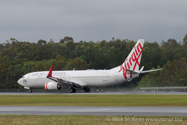 MMPI_20200208_MMPI0063_0005 - Virgin Australia Boeing 737-8FE VH-YFL as flight VA726 spraying water on its takeoff roll from Gold Coast Airport (YBCG) bound for Melbourne (YMML).