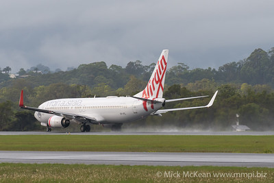 MMPI_20200208_MMPI0063_0006 - Virgin Australia Boeing 737-8FE VH-YFL as flight VA726 spraying water on its takeoff roll from Gold Coast Airport (YBCG) bound for Melbourne (YMML).