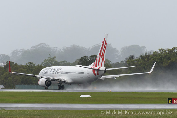 MMPI_20200208_MMPI0063_0029 - Virgin Australia Boeing 737-8FE VH-YFR as flight VA730 spraying water on its takeoff roll from Gold Coast Airport (YBCG) bound for Melbourne (YMML).