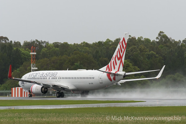 MMPI_20200208_MMPI0063_0028 - Virgin Australia Boeing 737-8FE VH-YFR as flight VA730 spraying water on its takeoff roll from Gold Coast Airport (YBCG) bound for Melbourne (YMML).