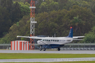 MMPI_20200208_MMPI0063_0022 -  Cessna 208B Grand Caravan VH-TLH takes off from Gold Coast Airport (YBCG) bound for Bundaberg (YBUD) with propeller vortices.