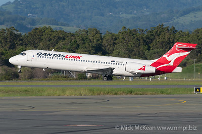 MMPI_20200216_MMPI0063_0008 - QantasLink Boeing 717-23S VH-NXE as flight QF1563 beginning its takeoff roll at Gold Coast Airport (YBCG) bound for Sydney (YSSY).
