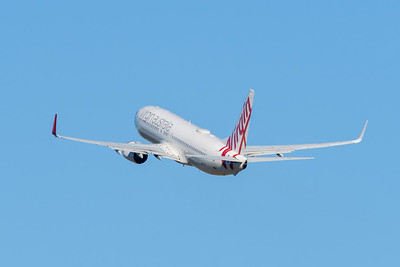 """MMPI_20200715_MMPI0063_0003 - Virgin Australia Boeing 737-8FE VH-YIZ """"Black Rock"""" as flight VA1388 takes off from Brisbane (YBBN) en route for Adelaide (YPAD)."""