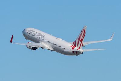 """MMPI_20200715_MMPI0063_0002 - Virgin Australia Boeing 737-8FE VH-YIZ """"Black Rock"""" as flight VA1388 takes off from Brisbane (YBBN) en route for Adelaide (YPAD)."""