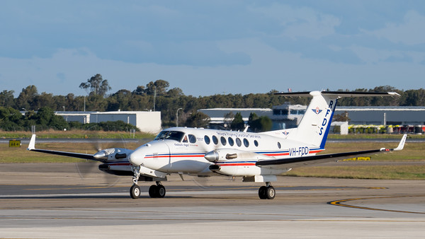 _7R40268 - Royal Flying Doctor Service Beech B300C King Air VH-FDD as flight VA612 taxiing after landing at Brisbane (YBBN) from Rockhampton (YBRK).