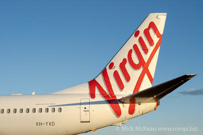 MMPI_20201101_MMPI0063_0011 - Virgin Australia Boeing 737-8FE VH-YVD tail detail while aircraft is parked on taxiway Papa.