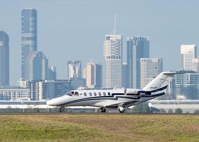 MMPI_20201126_MMPI0063_0007 - MachJet International Cessna 525A CitationJet CJ2 VH-ZIY taxiing after landing at Brisbane (YBBN) with Brisbane city skyline backdrop.
