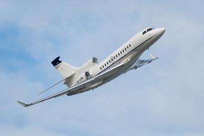MMPI_20210227_MMPI0078_0005 - Brenzil Pty Ltd Dassault Falcon 7X VH-CRW banking after takeoff from Brisbane (YBBN) en route to Ballina (YBNA).