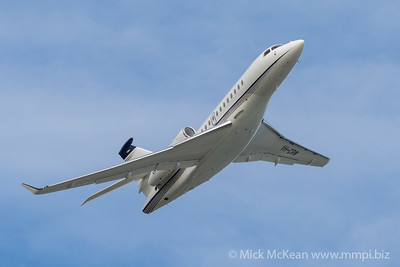 MMPI_20210227_MMPI0078_0006 - Brenzil Pty Ltd Dassault Falcon 7X VH-CRW banking after takeoff from Brisbane (YBBN) en route to Ballina (YBNA).