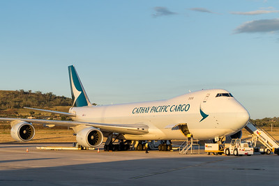 MMPI_20210309_MMPI0078_0009 - Cathay Pacific Cargo Boeing 747-867(F) B-LJB being loaded and turned around for flight in golden evening light.