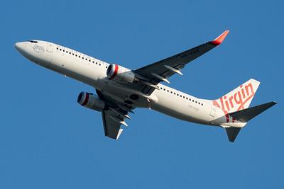 """MMPI_20210520_MMPI0078_0002 - Virgin Australia Boeing 737-8FE VH-VUG """"Jasmine Tasman"""" takes off from Brisbane (YBBN)."""
