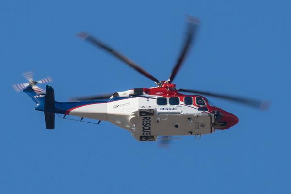 _7R49451 -  AgustaWestland AW139 VH-EGF overhead RAAF Amberley (YAMB) en route for a medical evacuation mission.