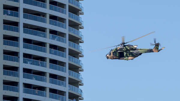 MMPI_20210923_MMPI0078_0023 - Australian Army NHIndustries MRH-90 Taipan A40-036 flies behind a tall building during its flying display practice for Brisbane Festival Riverfire 2021.
