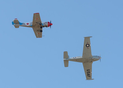 MMPI_20200627_MMPI0063_0160 -     Beech T-34A Mentor VH-XUS and Yakovlev Yak-52 VH-YFO flying in formation at QWVAA flying day.