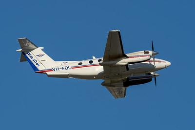 MMPI_20200809_MMPI0063_0001 - Royal Flying Doctor Service Beech B200 Super King Air VH-FDL as callsign FD493 takes off  from Brisbane (YBBN) en route to Bundaberg (YBUD).