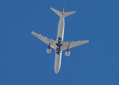 MMPI_20210516_MMPI0082_0140 -  Embraer 190-100IGW VH-UYW as flight QQ992 flies overhead Toowoomba City Aerodrome (YTWB)on a trip from Brisbane (YBBN) to Toowoomba Wellcamp (YBWW).