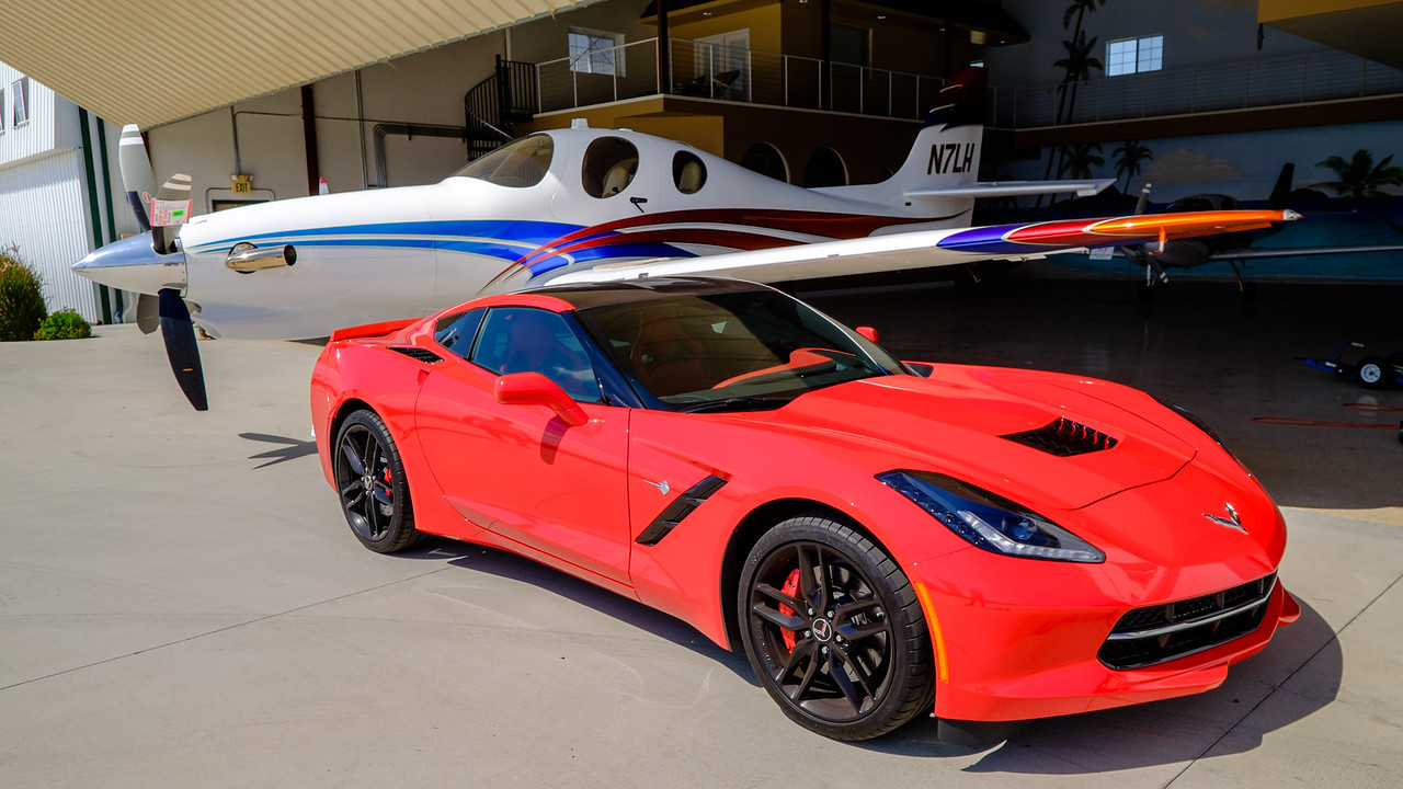 Fast car and plane at AOPA Regional Fly-in Chino, CA - 21SEP2014