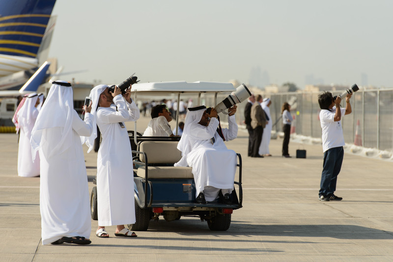 Photographers at work at Abu Dhabi Aviation Expo 2014