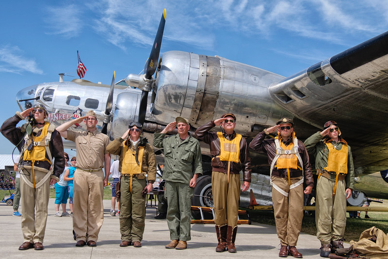 B-17 crew members saluting the US flag