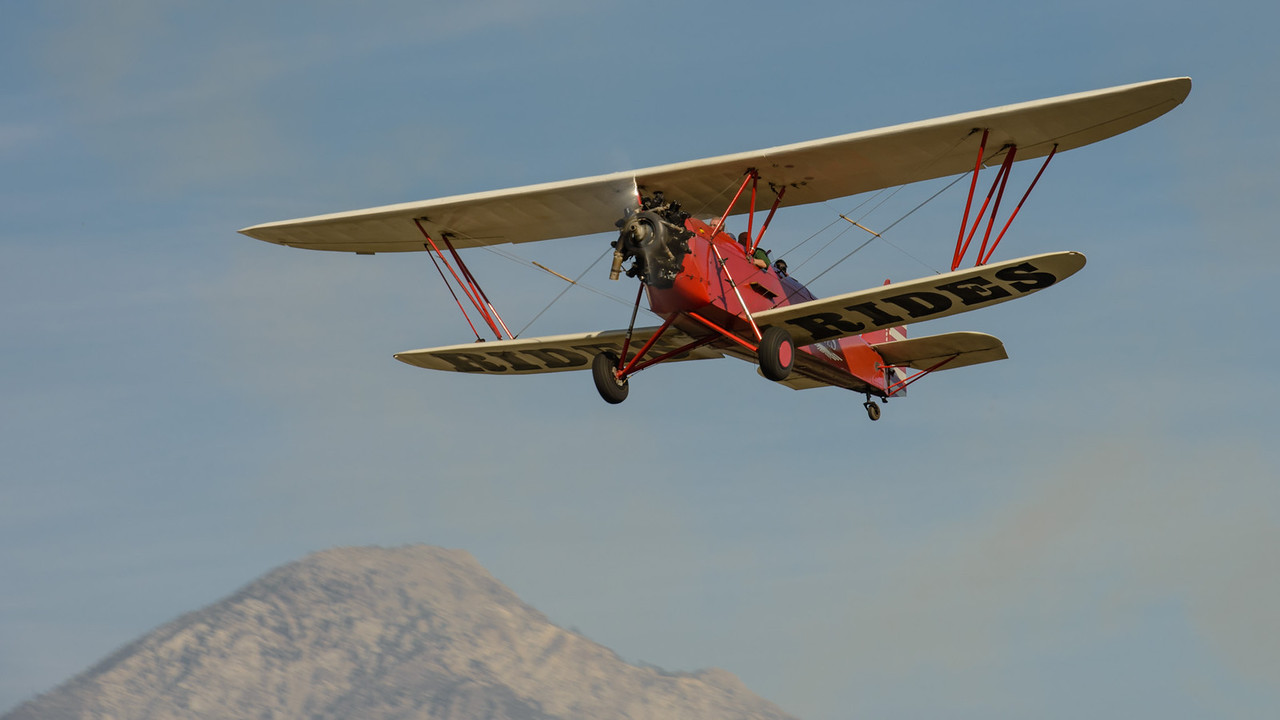 1930 New Standard D-25 Biplane taking off