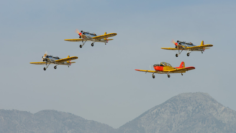 Ryan PT-22 Recruits in formation with Fokker S-11