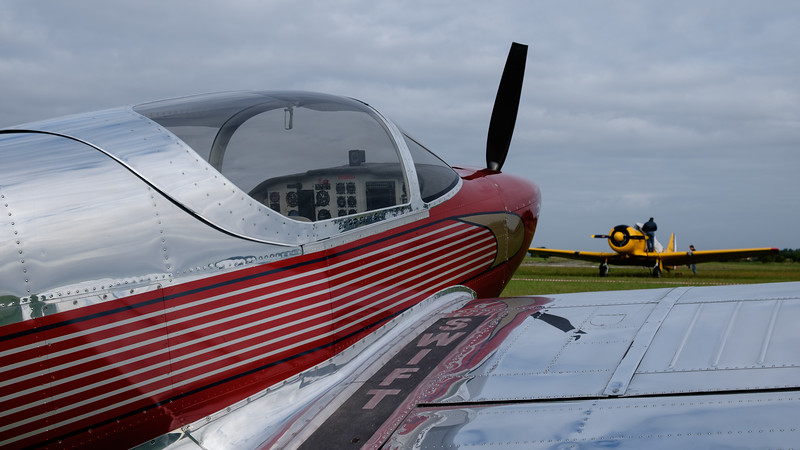 SWIFT with T-6 in the background