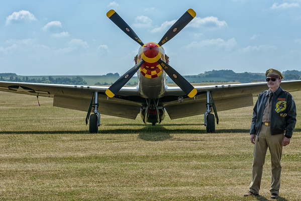 US Airforce pilot in outfit in front of P-51 Mustang