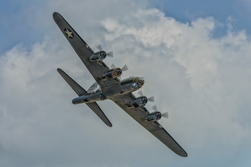 Boeing B-17 with stormy clouds