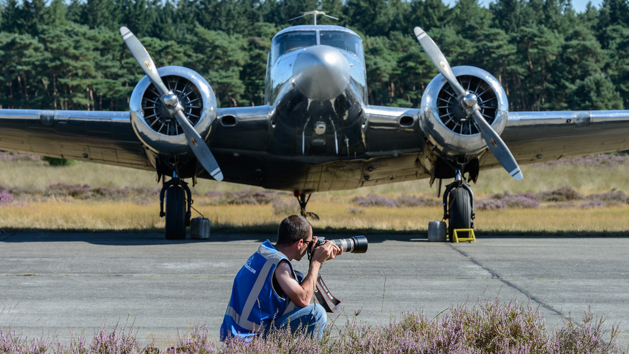 Photographer in front of Beechcraft 18