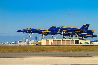 U.S. Navy Blue Angels taking off from NAS-JAX with downtown Jacksonville FL in the background