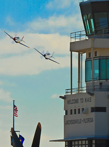 P-51 Mustangs buzz the tower at NAS-JAX.  These Mustangs belong to The Horseman Flying Team