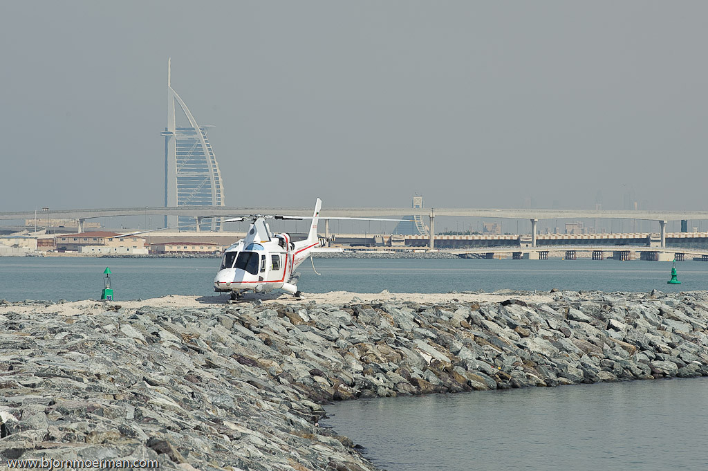 Police Agusta helicopter with Burj al Arab