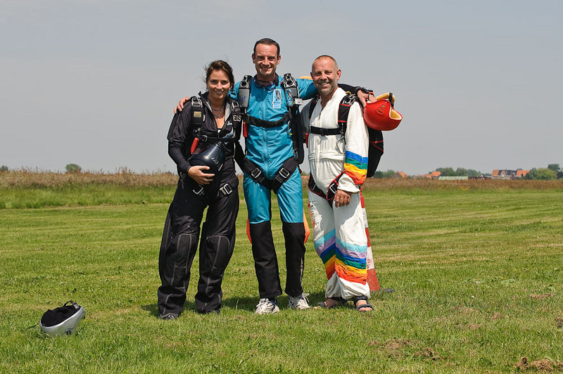 Ready for another Accelerated Free Fall (AFF) jump. Instructors left&right, trainee in the middle
