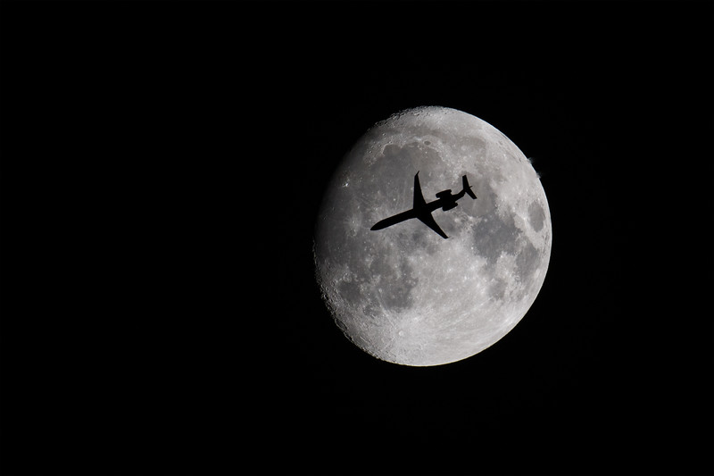 United Flight #4161 transits the waxing gibbous moon on December 19, 2018.