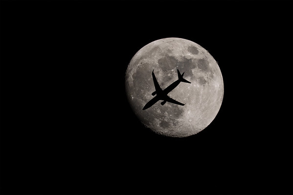 American Airlines Flight 336 from Chicago to New York is seen silhouetted by the moon on February 27, 2018.