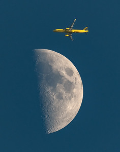 A first quarter moon provides a nice backdrop to Spirit Airlines flight 630 from Chicago to New York on July 19, 2018.