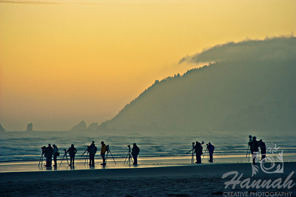 HONORABLE MENTION, Washington County Fair Photography Exhibition 2012  Class:  Color Prints  Lot:  Sunrise/Sunset  Description:  Row of photographers on the shore with yellow sky background trying to take photos before sunrise of the Haystack Rock in Cannon Beach, Oregon Coast ... this photo was also published for KGW NewsChannel 8 Portland.  © Copyright Hannah Pastrana Prieto