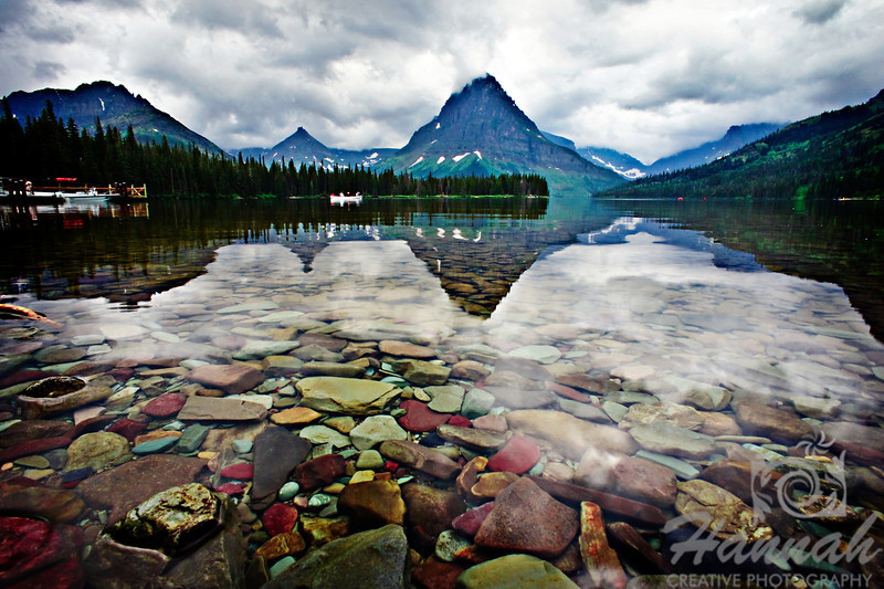 2nd PLACE RED RIBBON, Washington County Fair Photography Exhibition 2012  Class:  Color Prints  Lot:  Waterscape Description:  'Two Medicine Lake' at Glacier National Park in Montana with reflections of the mountains on the water and shot at a low angle to give emphasis to the colorful rocks. Location:  Two Medicine Lake at Glacier National Park in Montana, U.S.A.  © Copyright Hannah Pastrana Prieto