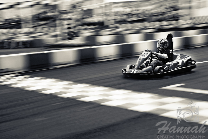 1st PLACE BLUE RIBBON, Washington County Fair Photography Exhibition 2013  Class: Black & White Lot:  Action Description:  A speeding go-kart driven by a boy, using panning method  © Copyright Hannah Pastrana Prieto