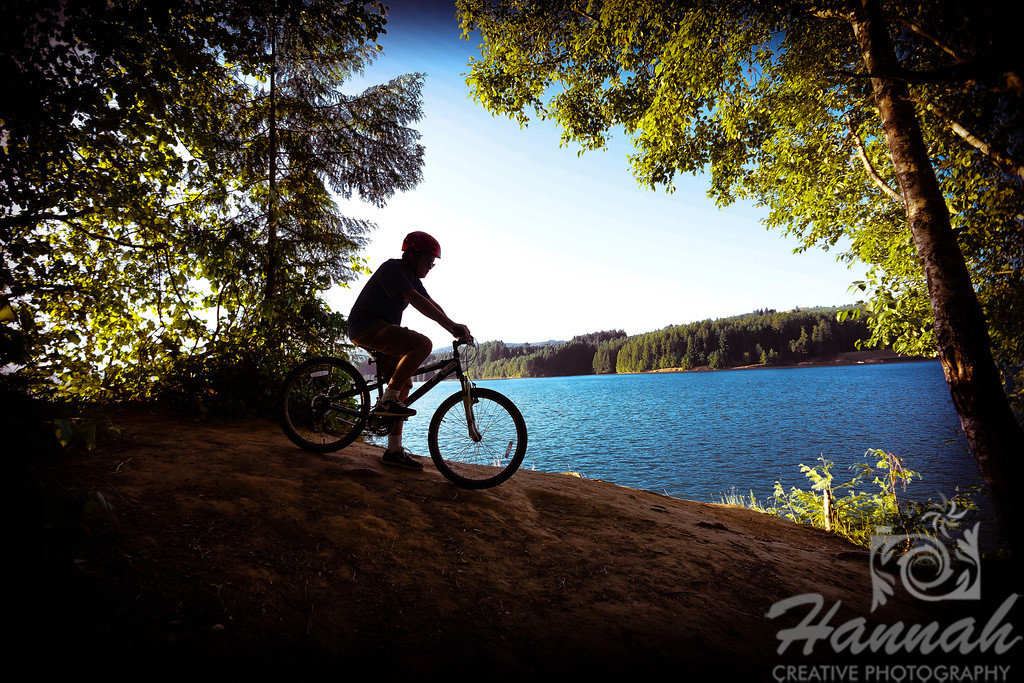 "1st PLACE BLUE RIBBON, Washington County Fair Photography Exhibition 2013  Class: Color Prints Lot:  ""Life in Washington County"" Description:  A silhouette of a boy biking downhill at Henry Hagg Lake Location:  Henry Hagg Lake, Gaston, Oregon  © Copyright Hannah Pastrana Prieto"