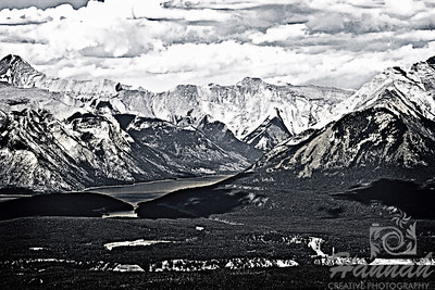 Exhibited at the Washington County Fair Photography Exhibition 2012  Class:   Black & White Lot:  Landscape Description:  A monochrome photo of Banff National Park in Alberta, Canada with snow, a tiny lake, vast forest and cloudy sky  Location:  Banff National Park in Alberta, Canada  © Copyright Hannah Pastrana Prieto
