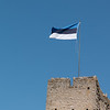 Estonian flag flies over the castle