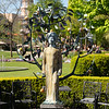 Statue of a woman & metal work fruit tree