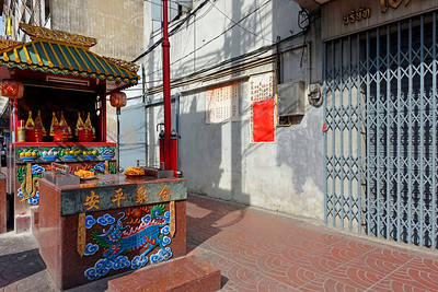 Small street-side temple in Chinatown, Bangkok